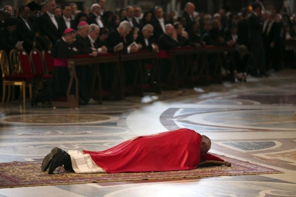 Pope Francis lies on the ground as he prays during the Celebration of the Lord's Passion in Saint Peter's Basilica at the Vatican April 18, 2014. REUTERS/Stringer (VATICAN - Tags: RELIGION) - RTR3LUMS