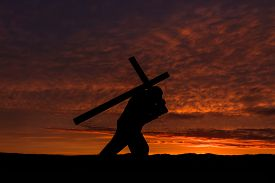 man_carrying_a_cross_on_his_back_with_a_cg1p55809115c_th