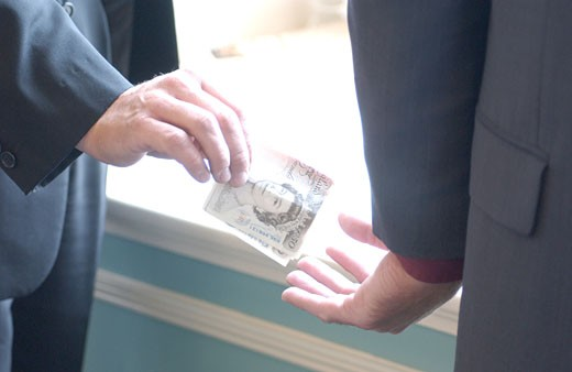 back hander bribe